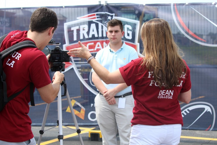 A student being filmed at the New England Patriots Training Camp at Gillette Stadium.